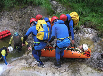 Mountain resue team recovering a casualty using a Sked Resue Stretcher