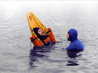 Casualty upright in the water with the SK-600 SKED Inflatable Flotation System